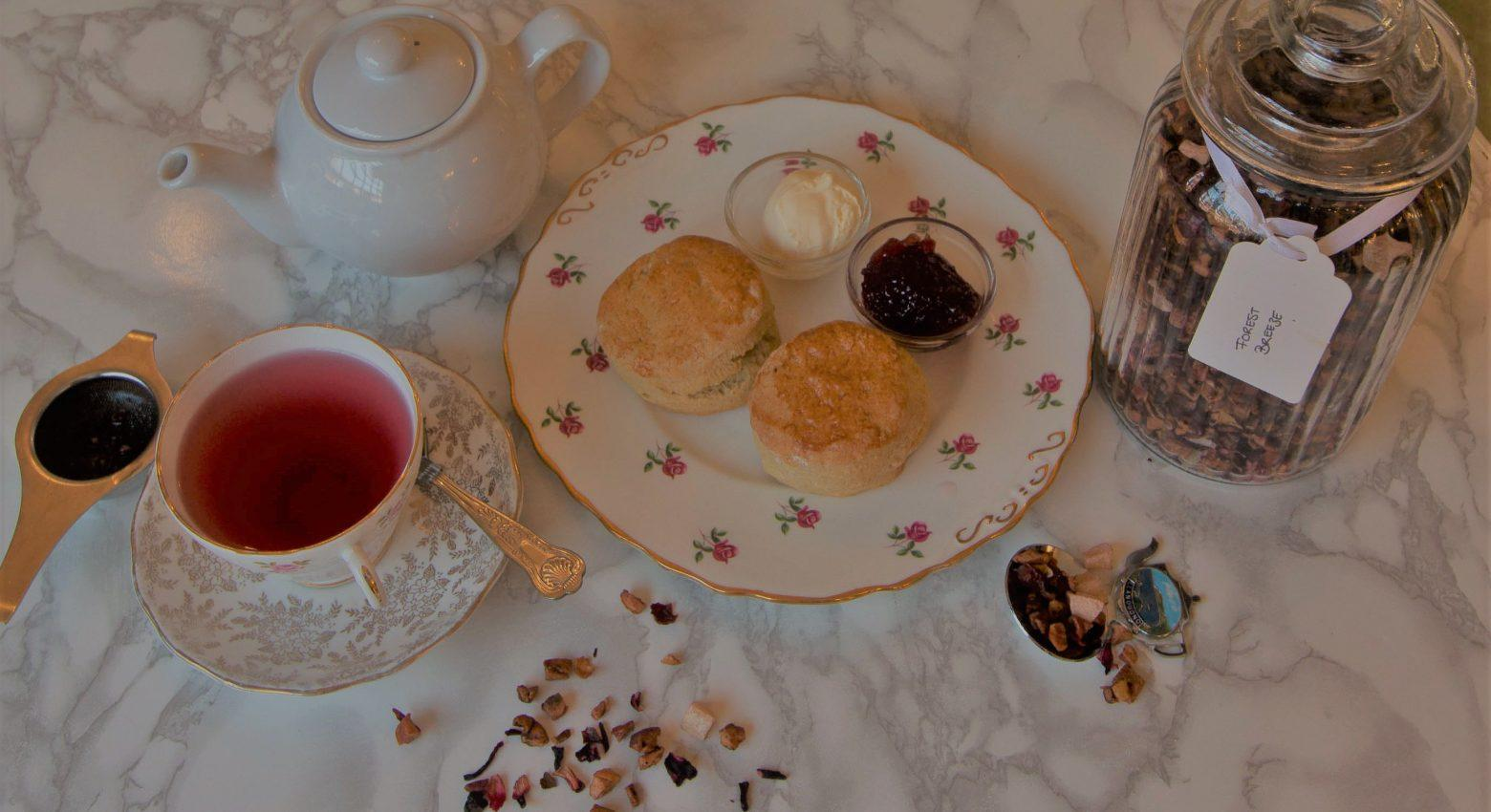 Cream tea with strawberry jam, clotted cream and loose leaf tea